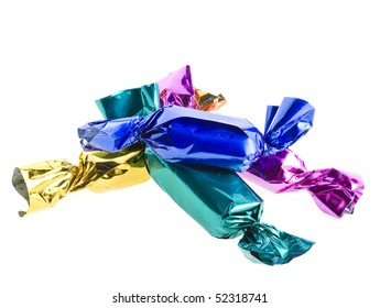candy in colored wrapper isolated on white background