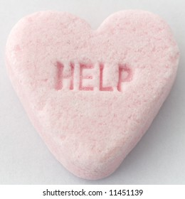 Candy conversation heart with 'HELP' text