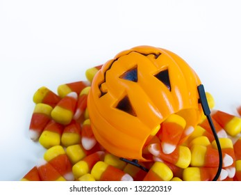 Candy corn candies falling out of Halloween treat bag.