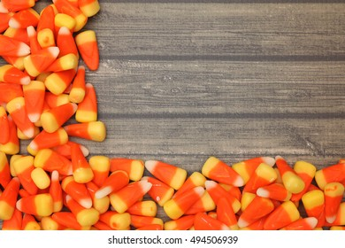 Candy Corn isolated on a Dark Wooden Table