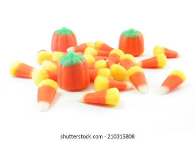 Candy corn and candy pumpkins, isolated on a white background.