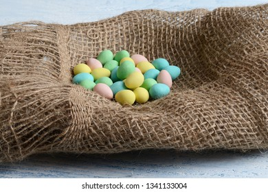 candy easter eggs in burlap nest