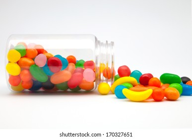 Candy in a glass jar on white background