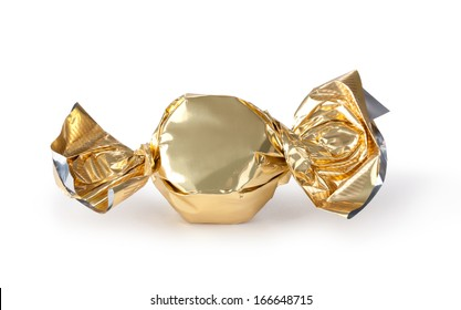 candy in golden wrapper isolated on white