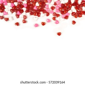 Candy hearts on a white background with space for copy.