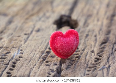 Candy Hearts on wood background