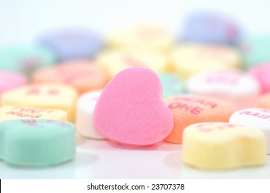 Candy hearts with shallow depth of field. One blank candy heart in focus and ready for custom message or logo.