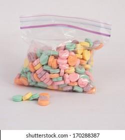 Candy hearts in a zipper bag.