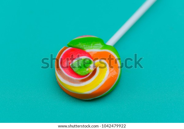 Candy lollipop on a green background.