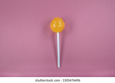 Candy Lollipop on pink background.