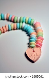 Candy necklace with Love U heart shaped pendant.