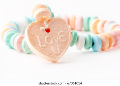 Candy necklace with Love U on it