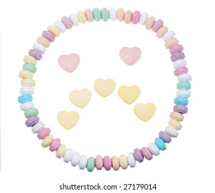 Candy necklace sad face isolated on a white background