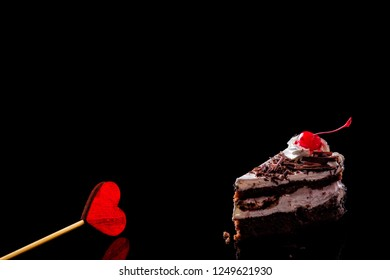 candy on a black background. Sweet valentine day. Space for text
