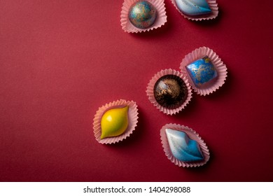 Candy on red background, food above