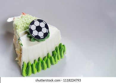 Candy is a soccer ball with thread and green grass that simulates. It is white and sweet.