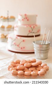 Candy table with a cake and macarons