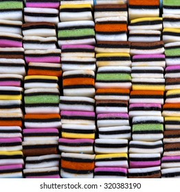 Candy variety with colourful liquorice sweets neatly organized in a square, stacked pattern