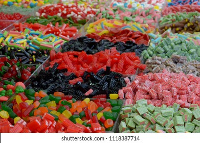 Candy-bar with jelly candies. Colorful background with assortment of gummy and jelly candies. Jelly sweets, candies and marmalade on a market. Unhealthy sugared jelly candies and sweets.