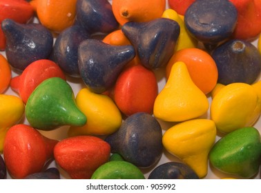 """candy-coated chocolate """"kiss"""" candy in closeup"""