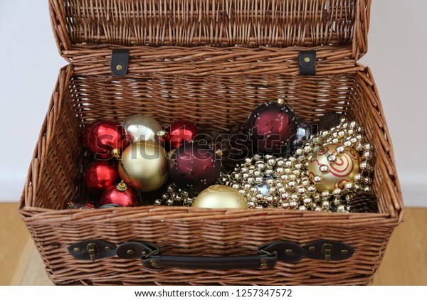 Cane Hamper Containing Christmas Decorations Baubles Stock