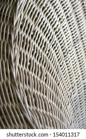 Cane or wickerwork background- showing the details of interlaced weave structure of basket or furniture