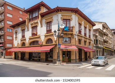 CANGAS DE ONIS, SPAIN - JUN 19, 2017: The building on the corner of avenues Covadonga and D. Constantino Glez Y Gonzalez