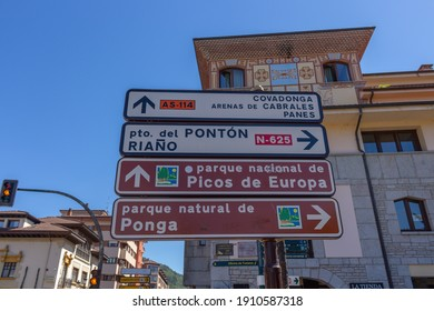 Cangas de Onis, Spain - September 4, 2020: Spanish Road Signs. Street signs at Cangas de Onis. Traffic directions to touristic points. Indicating to Covadonga and Picos de Europa National Park.