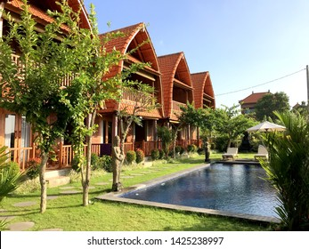Canggu - Bali, Indonesia - 06 08 2019: Beautiful hotel complex with traditional houses and a swimming pool