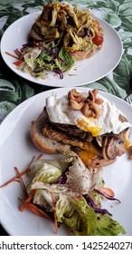 Canggu - Bali, Indonesia - 06 08 2019: Breakfast sandwich with fresh salad served in a café in Canggu