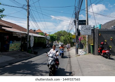 Canggu, Bali, Indonesia - 12th June 2019 : Street view of Jalan Pantai Beravwa Road, the famous street in Canggu with many trendy restaurants and caffees