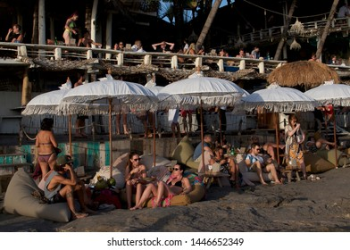 Canggu, Bali, Indonesia - 31st May 2019 : View of many people enjoying themselves at the Echo Beach just before sunset in Canggu, Bali - Indonesia