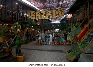 Canggu, Bali, Indonesia - 4th June 2019 : View on some tourist standing in front of a market stall at the famous Love Anchor Market in Canggu, Bali - Indonesia
