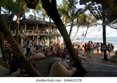 Canggu, Bali, Indonesia - 6th June 2019 : View on a beautiful beach restaurant terrace crowded with tourists at the famous Echo Beach in Canggu, Bali - Indonesia