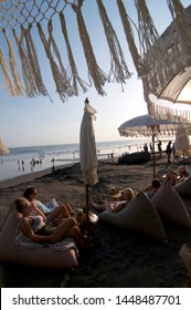 Canggu, Bali, Indonesia - 6th June 2019 : Tourists enjoy themselves on the beach bean bag at the famous Echo Beach in Canggu, Bali - Indonesia