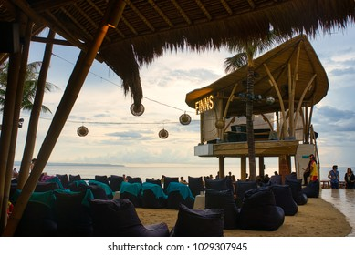 CANGGU, BALI, INDONESIA - JANUARY, 2018: DJ-place at Finns Beach Club with people hanging around during the day