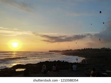 Canggu, Bali / Indonesia - September 4th 2018: Waves, kites, and the sunset in Canggu