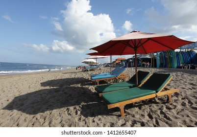 Canggu, Indonesia - May 27, 2019: Surfer beach and local shops of surf board rental waiting customer coming to rent during the day at Canggu Beach in Bali, Indonesia.
