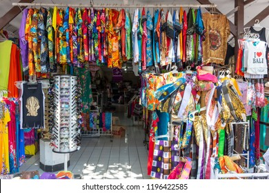Canggu, Indonesia - September 9, 2018: Souvenir shops selling clothes and other goods at Tanah Lot temple area.