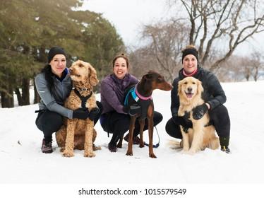 Canicross woman group have fun in winter season