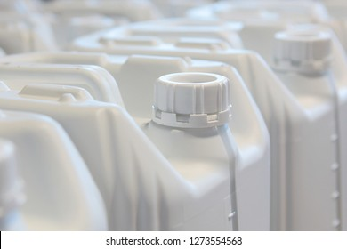 Canisters for liquid of white color from plastic. Empty canisters for filling with liquids of different types. Plastic containers for liquids.