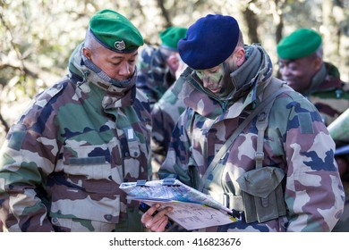 Canjuers, FRANCE - march 13. 2012.Noncommissioned officers discuss the plan of training maneuvers.