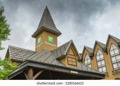 CANMORE, AB, CANADA - JUNE 2018: Exterior view of the front of the Holiday inn hotel in Canmore near Banff.