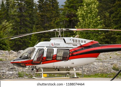 CANMORE, ALBERTA, CANADA - JUNE 2018: Bell 407 helicopter operated by Alpine Helicopters from its base in Canmore.