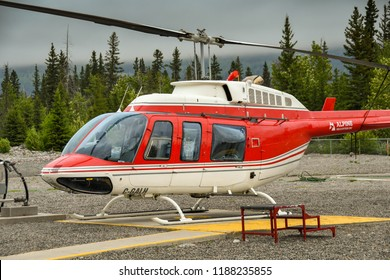 CANMORE, ALBERTA, CANADA - JUNE 2018: Close up view of a Bell 206 Longranger helicopter operated by Alpine Helicopters from its base in Canmore,
