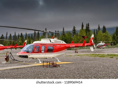 CANMORE, ALBERTA, CANADA - JUNE 2018: Helicopters lined up at the base of Alpine Helicopters in Canmore.