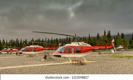CANMORE, ALBERTA, CANADA - JUNE 2018: Bell 206 Longranger helicopters lined up at the base of Alpine Helicopters in Canmore.