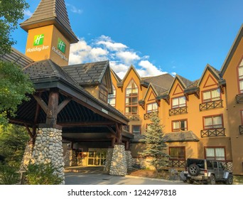 CANMORE, ALBERTA, CANADA - JUNE 2018: Exterior view of the Holiday Inn hotel on the outskirts of Canmore, Alberta.