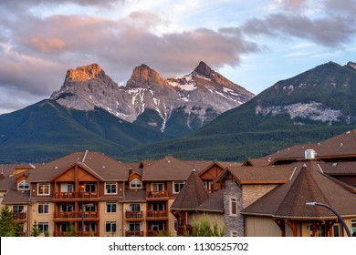 Canmore, Alberta, Canada - June 9, 2018: A Spring sunset view of The Three Sisters mountain, seen from mountain resort town of Canmore.