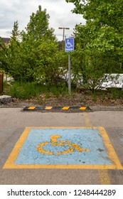 CANMORE, ALBERTA, CANADA - MAY 2018: Symbol marked on the surface of a parking bay reserved for disabled persons at a hotel in Canmore, Alberta